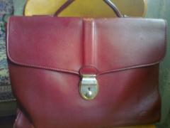 Beautiful raspberry leather briefcase. Holland